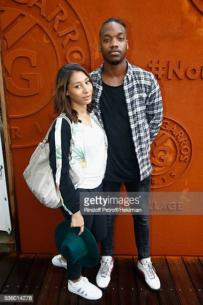 Ahmed Drame and his girlfriend attend day ten of the French Open 2016 at Roland Garros on May 31 2016 in Paris France