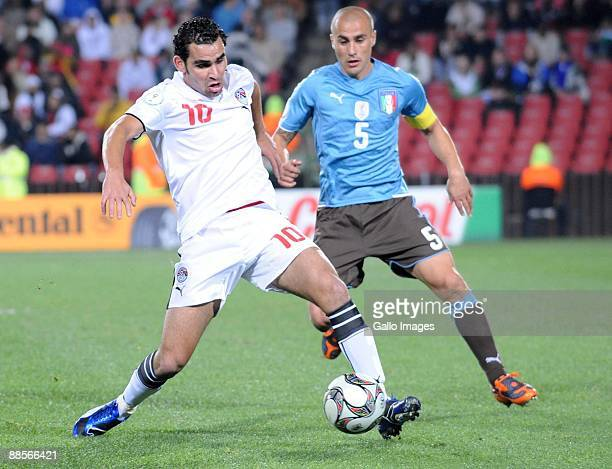 Ahmed Eid of Egypt and Fabio Cannavaro of Italy battle during the 2009 Confederations Cup match between Egypt and Italy at CocaCola Stadium on June...
