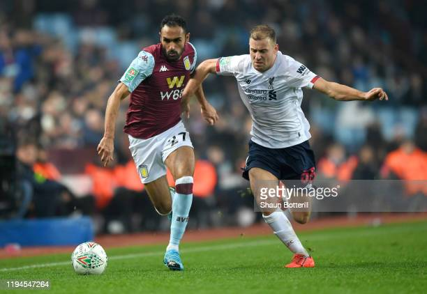 Ahmed El Mohamady of Aston Villa battles for possession with Herbie Kane of Liverpool during the Carabao Cup Quarter Final match between Aston Villa...