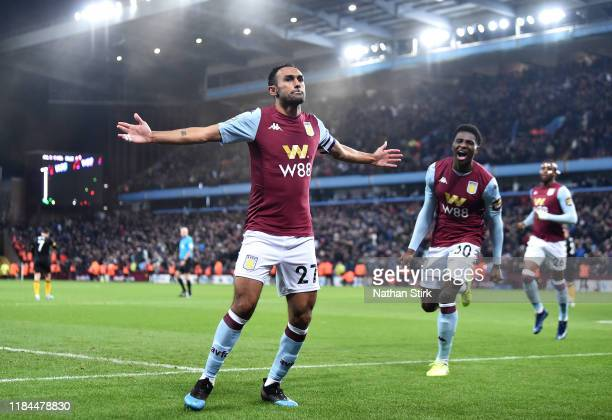 Ahmed El Mohamady of Aston Villa celebrates with Kortney Hause after scoring his team's second goal during the Carabao Cup Round of 16 match between...