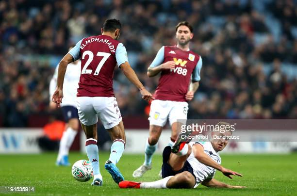 Ahmed El Mohamady of Aston Villa tackles Luis Longstaff of Liverpool FC during the Carabao Cup Quarter Final match between Aston Villa and Liverpool...