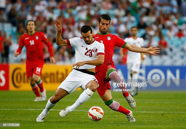 Ahmed El Sayed of Qatar fights the ball against Ehsan Hajsafi of Iran during the 2015 Asian Cup match between Qatar and IR Iran at ANZ Stadium on...