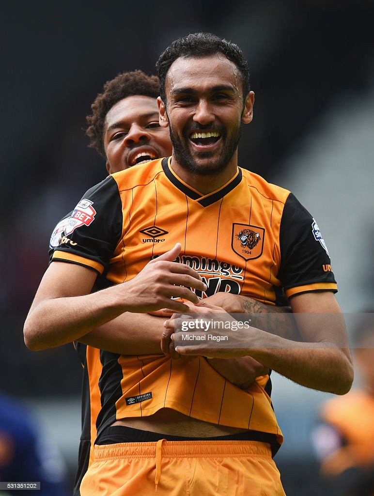 Ahmed Elmohamady (front) and Chuba Akpom of Hull City celebrate victory after the Sky Bet Championship Play Off semi final first leg match between Derby County and Hull City at the iPro Stadium on May 14, 2016 in Derby, England.