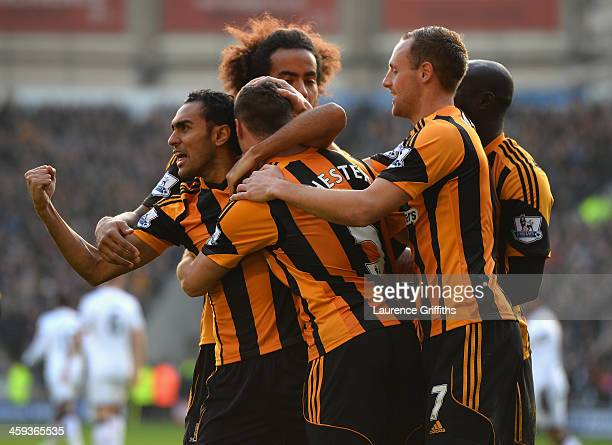 Ahmed Elmohamady congratulates James Chester of Hull City after scoring the opening goal during the Barclays Premier League match between Hull City...