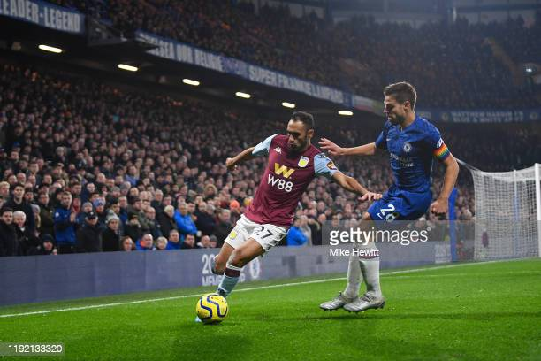 Ahmed Elmohamady of Aston Villa is challenged by Cesar Azpilicueta of Chelsea during the Premier League match between Chelsea FC and Aston Villa at...