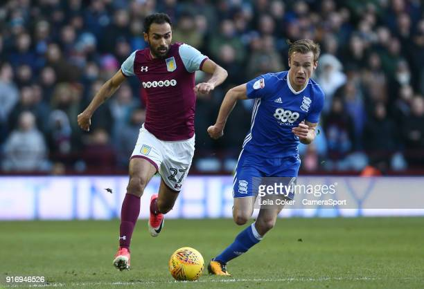 Ahmed Elmohamady of Aston Villa loses the ball to Maikel Kieftenbeld of Birmingham City during the Sky Bet Championship match between Aston Villa and...