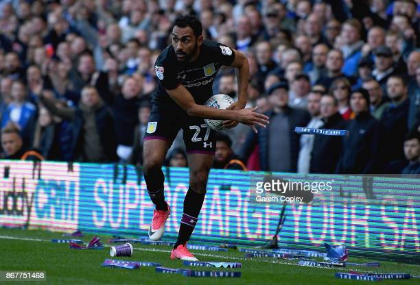 Ahmed Elmohamady of Aston Villa removes 'clappers' from the pitch during the Sky Bet Championship match between Birmingham City and Aston Villa at St...