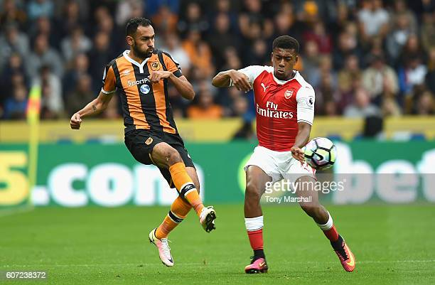 Ahmed Elmohamady of Hull CAhmed Elmohamady of Hull City and Alex Iwobi of ArseAlex Iwobi of Arsenal battle for possession during the Premier League...