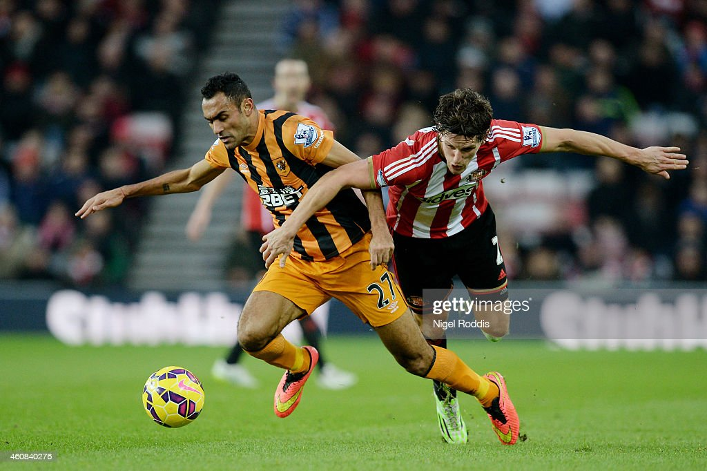 Ahmed Elmohamady of Hull City and Billy Jones of Sunderland battle for the ball during the Barclays Premier League match between Sunderland and Hull City at the Stadium of Light on December 26, 2014 in Sunderland, England.