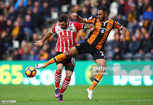 Ahmed Elmohamady of Hull City and Charlie Austin of Southampton in action during the Premier League match between Hull City and Southampton at KC...