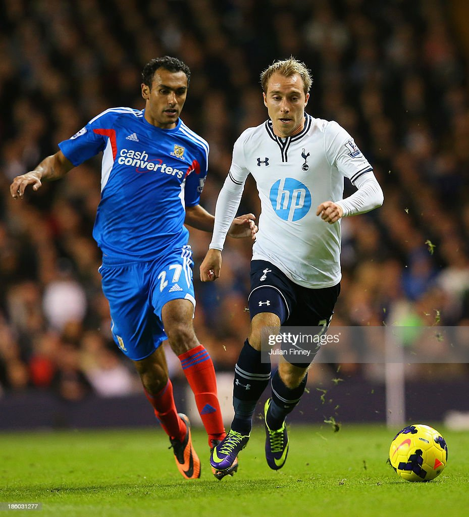 Ahmed Elmohamady of Hull City and Christian Eriksen of Spurs compete for the ball during the Barclays Premier League match between Tottenham Hotspur and Hull City at White Hart Lane on October 27, 2013 in London, England.