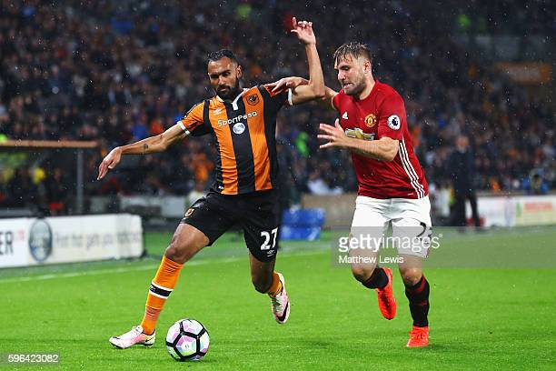 Ahmed Elmohamady of Hull City and Luke Shaw of Manchester United battle for possession during the Premier League match between Hull City and...
