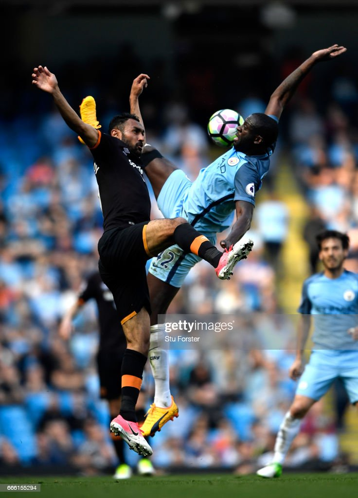Ahmed Elmohamady of Hull City (L) and Yaya Toure of Manchester City (R) battle for possession during the Premier League match between Manchester City and Hull City at Etihad Stadium on April 8, 2017 in Manchester, England.