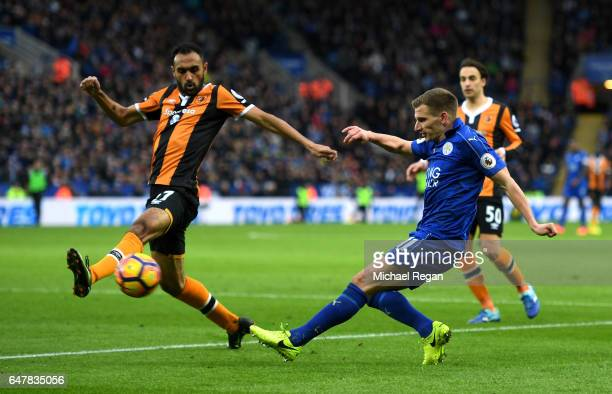 Ahmed Elmohamady of Hull City attempts to block Marc Albrighton of Leicester City cross during the Premier League match between Leicester City and...