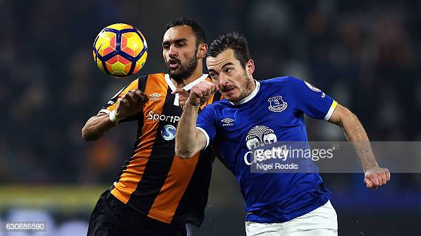 Ahmed Elmohamady of Hull City battles for the ball with Leighton Baines of Everton during the Premier League match between Hull City and Everton at...