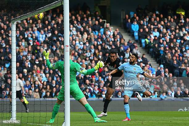 Ahmed Elmohamady of Hull City hits the bar during the Barclays Premier League match between Manchester City and Hull City at the Etihad Stadium on...