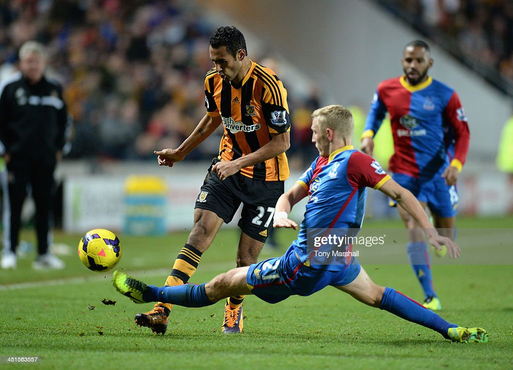 Ahmed Elmohamady of Hull City is tackled by Dean Moxey of Crystal Palace during the Barclays Premier League match between Hull City and Crystal Palace at KC Stadium on November 23, 2013 in Hull, England.