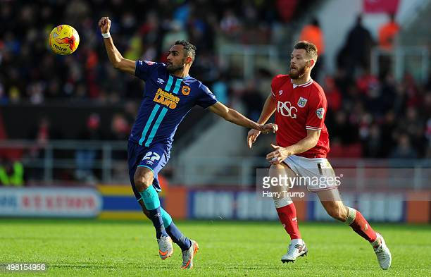 Ahmed Elmohamady of Hull City is tackled by Nathan Baker of Bristol City during the Sky Bet Championship match between Bristol City and Hull City at...