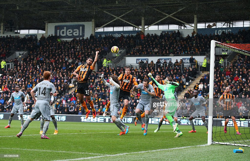 Ahmed Elmohamady of Hull City punches the ball into the Newcastle net during the Barclays Premier League match between Hull City and Newcastle United at KC Stadium on January 31, 2015 in Hull, England.