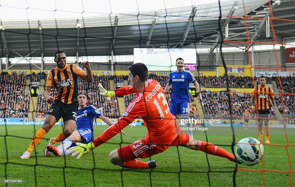 Ahmed Elmohamady of Hull City (27) shoots past goalkeeper Thibaut Courtois of Chelsea to score their first goal during the Barclays Premier League match between Hull City and Chelsea at KC Stadium on March 22, 2015 in Hull, England.