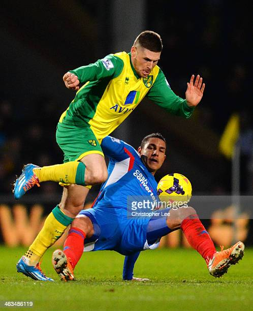 Ahmed Elmohamady of Hull City tackles Gary Hooper of Norwich City during the Barclays Premier League match between Norwich City and Hull City at...