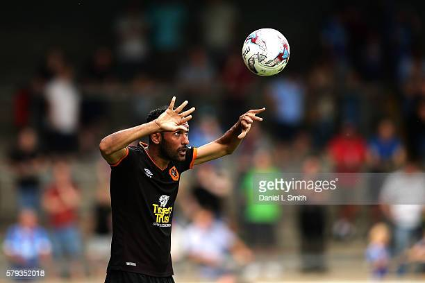 Ahmed Elmohamady of Hull City throws the ball in to play during the preseason friendly between Scunthorpe United and Hull City at Glanford Park on...