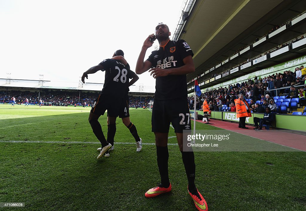 Ahmed Elmohamady of Hull City uses a phone during the Barclays Premier League match between Crystal Palace and Hull City at Selhurst Park on April 25, 2015 in London, England.