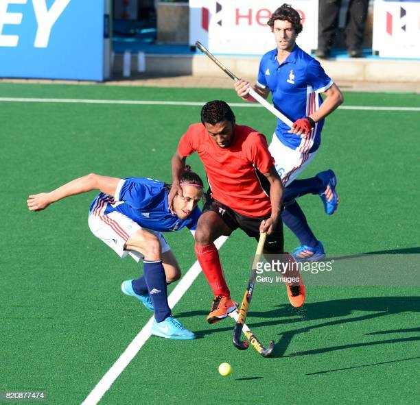 Ahmed Elnaggar of Egypt tackled by Francois Goyet of France during day 8 of the FIH Hockey World League Men's Semi Finals 7th8th place match between...