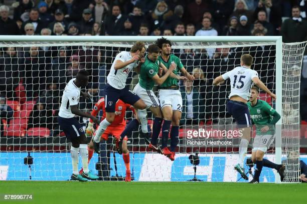 Ahmed ElSayed Hegazi and Jonny Evans of West Bromwich Albion clash heads during the Premier League match between Tottenham Hotspur and West Bromwich...