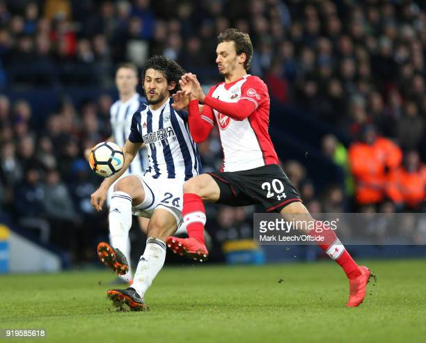 Ahmed ElSayed Hegazi of West Brom is challenged by Manolo Gabbiadini of Southampton during the FA Cup Fifth Round match between West Bromwich Albion...