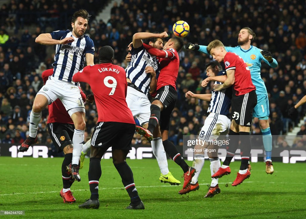 Ahmed El-Sayed Hegazi of West Bromwich Albion and Chris Smalling of Manchester United compete for the ball during the Premier League match between West Bromwich Albion and Manchester United at The Hawthorns on December 17, 2017 in West Bromwich, England.