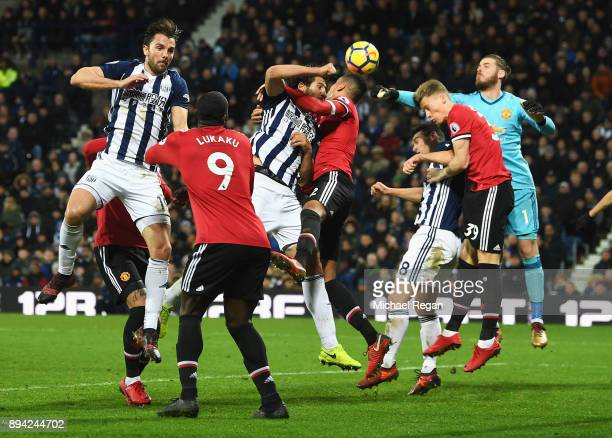 Ahmed ElSayed Hegazi of West Bromwich Albion and Chris Smalling of Manchester United compete for the ball during the Premier League match between...