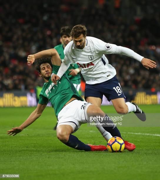 Ahmed ElSayed Hegazi of West Bromwich Albion and Fernando Llorente of Tottenham Hotspur clash during the Premier League match between Tottenham...