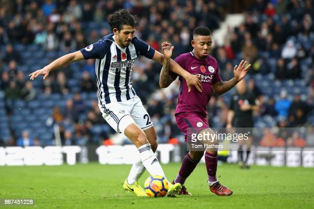 Ahmed ElSayed Hegazi of West Bromwich Albion and Gabriel Jesus of Manchester City battle for possession during the Premier League match between West...