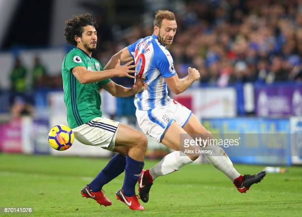 Ahmed ElSayed Hegazi of West Bromwich Albion and Laurent Depoitre of Huddersfield Town in action during the Premier League match between Huddersfield...