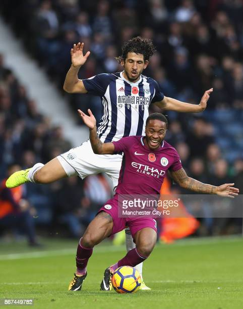 Ahmed ElSayed Hegazi of West Bromwich Albion and Raheem Sterling of Manchester City battle for possesion during the Premier League match between West...