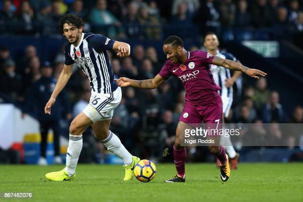 Ahmed ElSayed Hegazi of West Bromwich Albion and Raheem Sterling of Manchester City battle for possession during the Premier League match between...