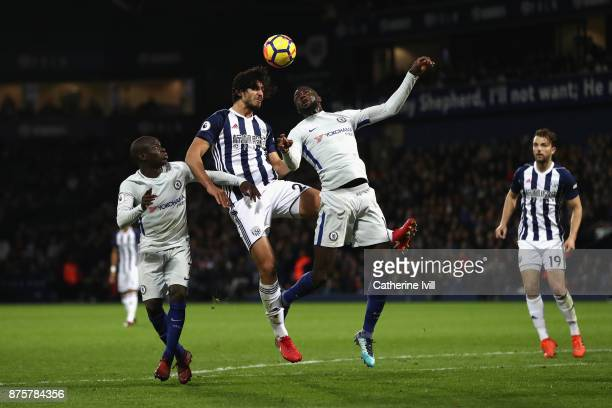 Ahmed ElSayed Hegazi of West Bromwich Albion competes for the ball against N'Golo Kante and Tiemoue Bakayoko of Chelsea during the Premier League...
