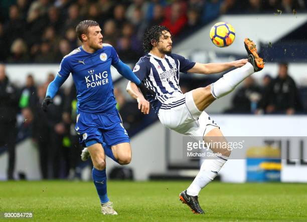 Ahmed ElSayed Hegazi of West Bromwich Albion controls the ball ahead of Jamie Vardy of Leicester City during the Premier League match between West...