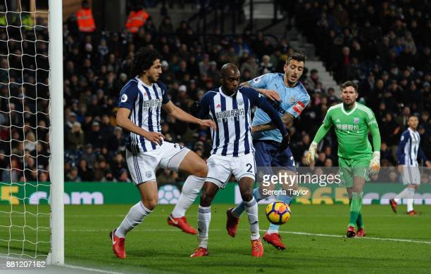 Ahmed ElSayed Hegazi of West Bromwich Albion controls the ball whilst Joselu of Newcastle United puts on pressure as West Bromwich Albion Goalkeeper...