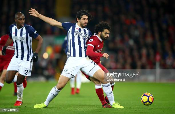 Ahmed ElSayed Hegazi of West Bromwich Albion tackles Mohamed Salah of Liverpool during the Premier League match between Liverpool and West Bromwich...