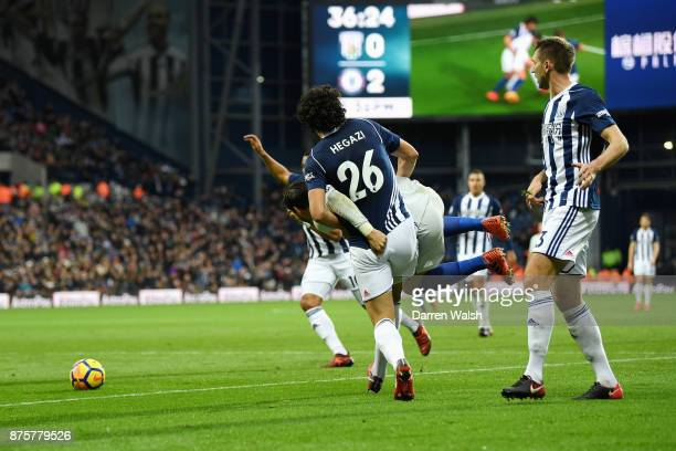 Ahmed ElSayed Hegazi of West Bromwich Albion tangles with Alvaro Morata of Chelsea during the Premier League match between West Bromwich Albion and...
