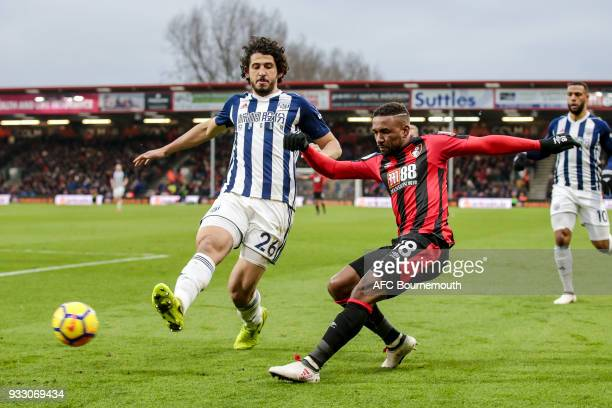 Ahmed ElSayed Hegazy of West Bromwich Albion and Jermain Defoe of Bournemouth during the Premier League match between AFC Bournemouth and West...