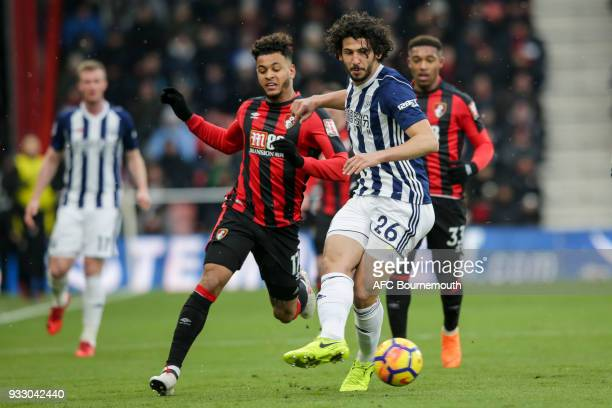 Ahmed ElSayed Hegazy of West Bromwich Albion clears from Joshua King of Bournemouth during the Premier League match between AFC Bournemouth and West...