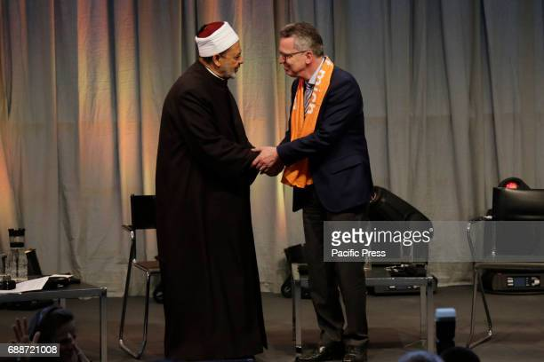 Ahmed elTayeb and Thomas de Maiziere shake hands at the end The Grand Imam of alAzhar Ahmed elTayeb and Thomas de Maiziere the German Federal...