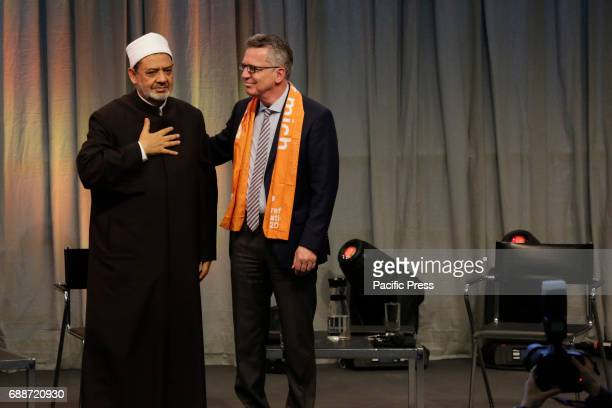 Ahmed elTayeb lays his hand on his heart while Thomas de Maiziere stands next to him The Grand Imam of alAzhar Ahmed elTayeb and Thomas de Maiziere...
