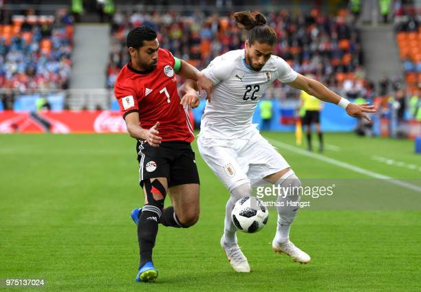 Ahmed Fathi of Egypt and Martin Caceres of Uruguay battle for the ball during the 2018 FIFA World Cup Russia group A match between Egypt and Uruguay...