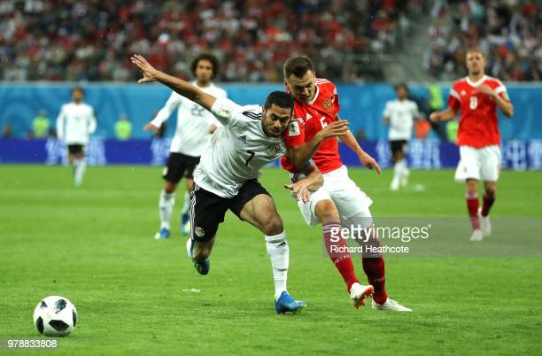 Ahmed Fathi of Egypt challenge for the ball withDenis Cheryshev of Russia during the 2018 FIFA World Cup Russia group A match between Russia and...