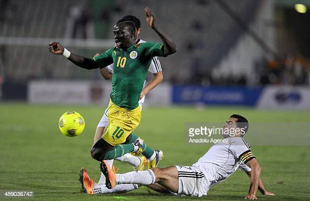 Ahmed Fathi of Egypt in action against Sadio Mané of Senegal during the Africa Cup of Nations qualification group G match between Egypt and Senegal...