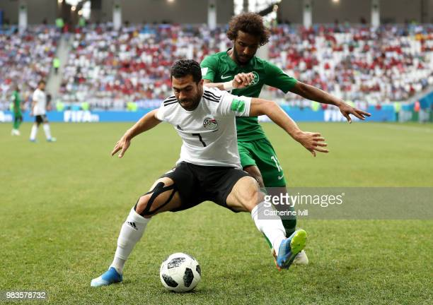 Ahmed Fathi of Egypt is challenged by Yasir Alshahrani of Saudi Arabia during the 2018 FIFA World Cup Russia group A match between Saudia Arabia and...